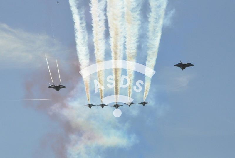 Thunderbirds and F-22 over Paris